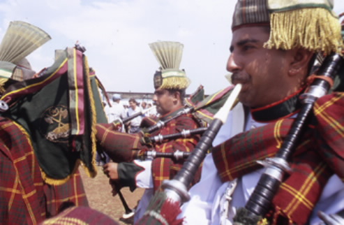Pakistani troops in kilts play the bagpipes in a marching band       attached to MONUC 'peacekeeping' operations in South Kivu, DRC. Photo copyright Keith Harmon Snow, July 2005.