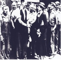 - Secretary of Labor Frances Perkins shakes hands with Carnegie Steel Workers during a tour of Homestead, Pennsylvania, July 1933.