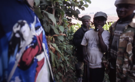 Twelve year-old Hutu child soldiers with the Forces for the Democratic Liberation of Rwanda (FDLR) in Congo—so-called genocidaires who purportedly fled Rwanda in 1994 and have served as Kagame's justification for plundering and depopulating Congo since. Photo keith harmon snow, South Kivu, DRC, 2006.