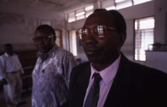 The rights and due process of Rwandan Hutus are systematically violated due to victor's justice secured by the U.S., Europe, Israel and the proxy states Uganda, Tanzania and Rwanda. Bernard Ntuyahaga, a Major of the former Rwandan army (ex-FAR) accused of killing 10 Belgian soldiers and Prime Minister Agathe Uwilingiyimana, surrendered to the ICTR to avoid extradition to Rwanda; he was tried in Belgium and sentenced to 20 years in prison on July 4, 2007. Photo keith harmon snow, Tanzania, 2000.