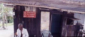 """""""Suffering provides good counsel"""" -- Local villages around Sette Cama are run down, dilapidated examples of the parallel (Apartheid) economies of exploitation and oil seen widely in Gabon, as all across Africa. Photo keith harmon snow, December 2004."""