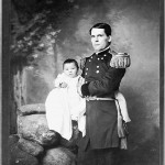 Gen. L. W. Colby holding Zintkala Nuni or Little Lost Bird, found on the Wounded Knee battlefield.