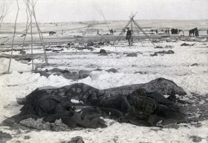 The scene three weeks afterwards, with several bodies partially wrapped in blankets in the foreground.