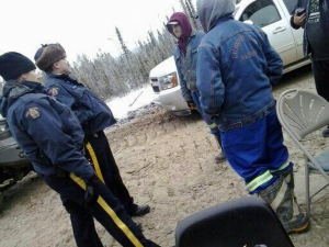 Peace River RCMP confront members of the Lubicon Lake Nation on Wednesday who are currently blocking Penn West from fracking on their traditional territory by occupying an access road. Photo: Lubicon Lake Cree Nation