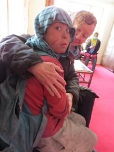 "Kathy Kelly with Safar, an Afghan ""street child"""
