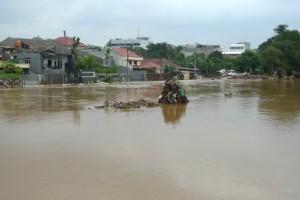 Kampung Melayu flooded.