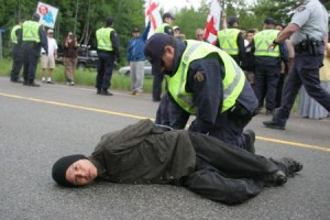Segewa't Na'gu'set, one of the fire keepers at the sacred fire encampment, was among 12 people arrested at a peaceful protest along highway 126 on June 21st, National Aboriginal Day. Photo by Miles Howe