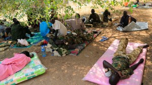 Wounded South Sudan military personnel receive medical treatment under a tree at the general military hospital compound in the capital Juba December 28, 2013. (Reuters/James Akena)