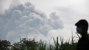 Volcanic ash from a major eruption in Indonesia shrouded a large swath of the country's most densely populated island on Friday, closed three international airports and sent thousands fleeing. Picture: AP Photo/Trisnadi Source: AP
