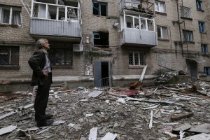 A man looks at a residential building, where he resides, which was damaged by what locals say was overnight shelling by Ukrainian forces, in the eastern Ukrainian town of Slaviansk June 12, 2014. (Reuters/Gleb Garanich)
