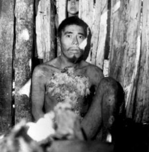 Aché man shortly after he was captured and brought out of the forest to the Aché Reservation. Paraguay, 1972. © A. Kohmann/Survival