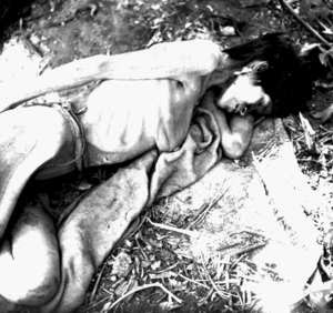 An Aché woman shortly after she was captured and brought out of the forest to the Aché Reservation. Paraguay, 1972. © A. Kohmann/Surviva