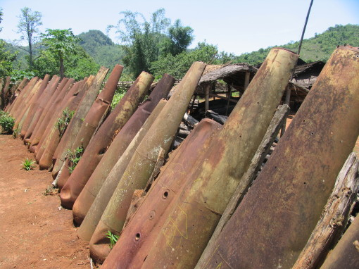 Laos-Plain-of-Jars-village-fence-made-of-American-bombs-copy-2-510x382
