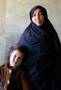 Safeh Zakira stands with her youngest daughter, age 5.