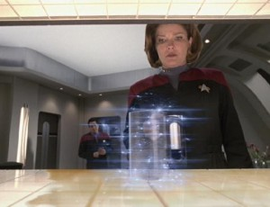 Captain Janeway has replicator reconstitute matter.